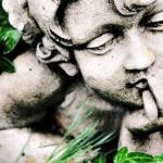 Cherub Statue In Grass